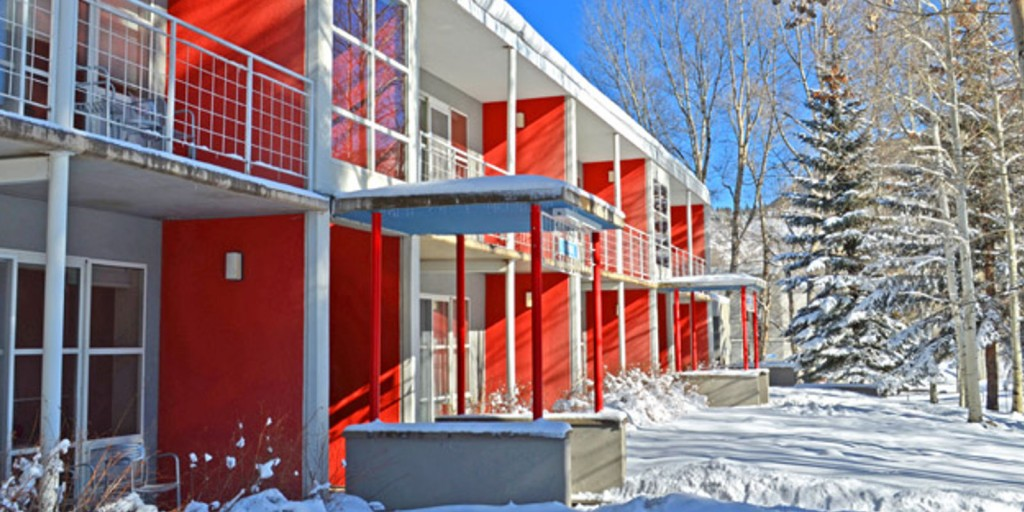 Bright red paint accents the simple Bauhaus architecture.