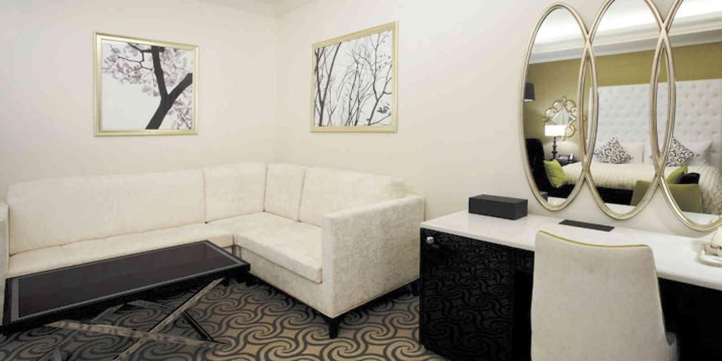 Atrium Suite sitting area with fresh white tones.