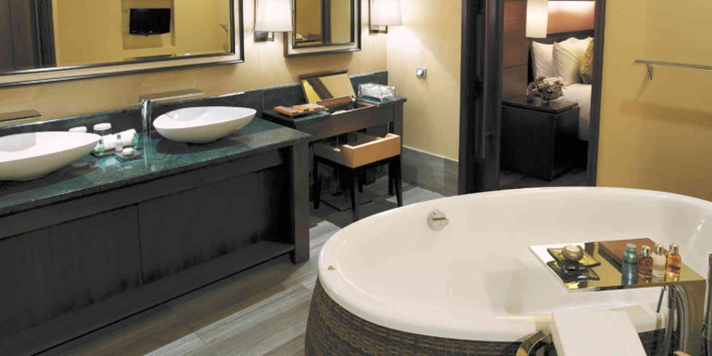 A wonderful earth-toned bathroom with soaking tub in an Atrium Suite.