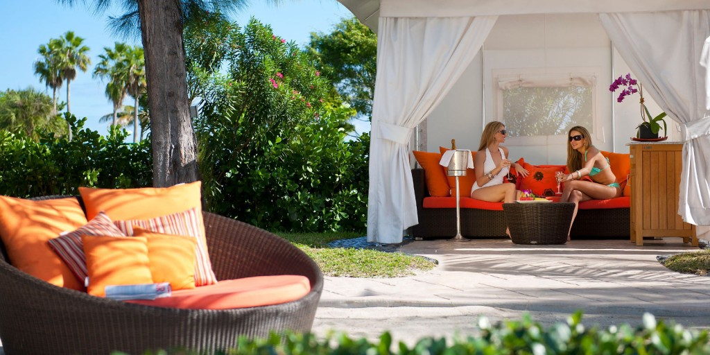 Beach chairs and cabanas make the beach deck your playground.