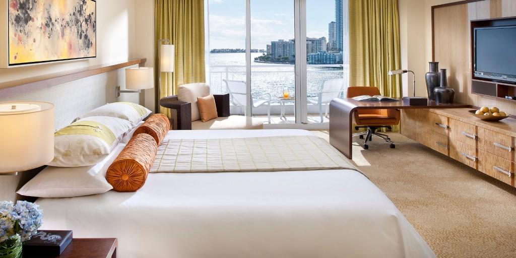 Enjoy the Miami Bay view from your Oriental-inspired luxury bedroom.