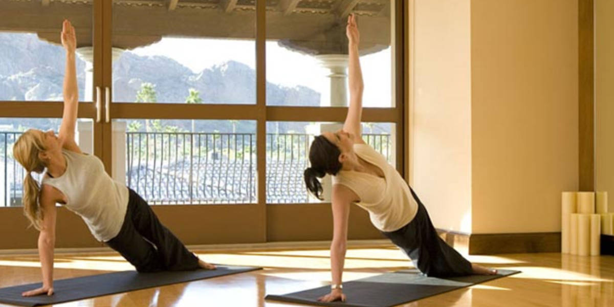 Exercise in indoor or outdoor spaces overlooking the picturesque Camelback Mountain area.