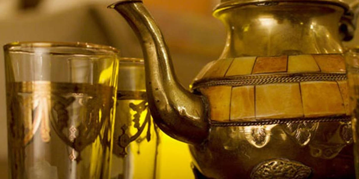 Aromatic teas are beautifully presented in Moroccan tableware.